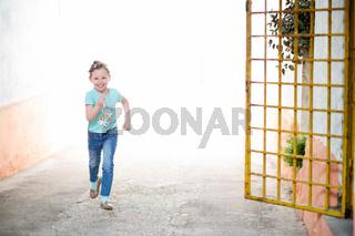 little girl running on the city streets