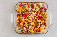 Baked vegetables with feta cheese in the pan