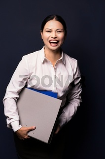 Portrait of young happy smiling business woman with folder