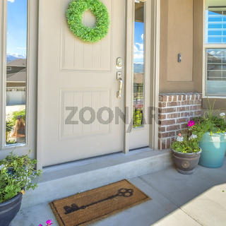 Square frame Front door with wreath transom window and sideligts at the facade of a home