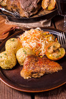 classic and crispy roasted duck with cabbage and dumplings