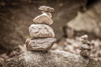 Balancing cairns in the forest