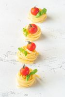 Raw fettuccine with tomatoes
