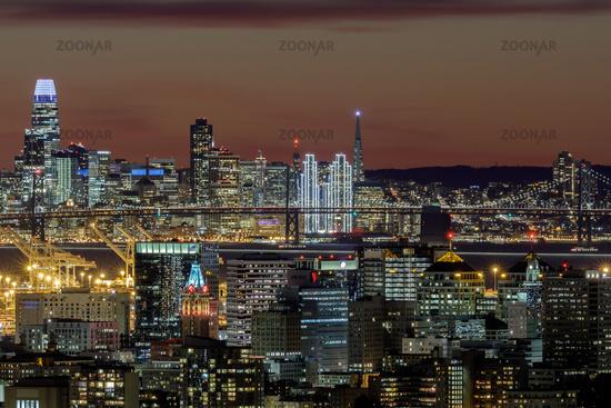Oakland and San Francisco Twilight Skylines Illuminated with Holiday Lights.