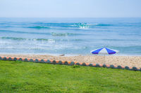 Sea and beach views with green grass