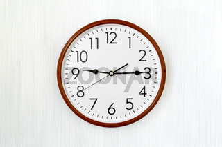 Simple round clock on a wall