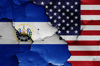 flags of El Salvador and USA painted on cracked wall