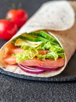 Tortilla wrap with salmon and vegetables