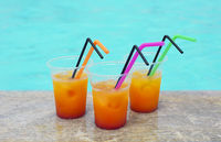Glasses of tropical cocktail on poolside