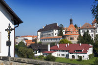 View from the hill with a crucifix (inscription in Czech- with Christ the world will be saved) on renaissance style castle