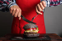 Man cuttung burger