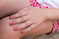 Baby girl with pink nail polish