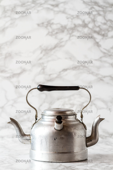 Old Aluminium Teapot with Double Outlet on Marble