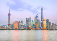 Illuminated Shanghai skyline at twilight