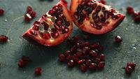 Ripe pomegranate halves on board