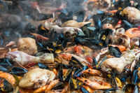 Close up image of paella with seafood and chicken.