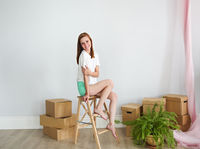 Young woman in new apartment after moving in