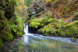 Waterfall in Doubravka valley  in autumn, Highlands in Czech Republic.