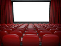 Movie theater with cinema blank screen and rows of red seats.