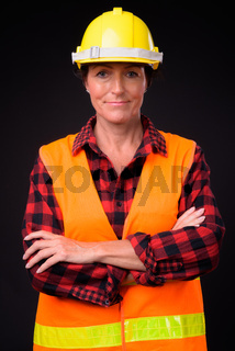 Mature beautiful woman construction worker with short hair again