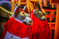 Fox statues at Fushimi Inari Taisha, Kyoto, Japan