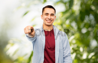 man pointing finger to you over white background