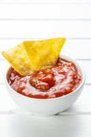 Corn nacho chips and tomato dip.