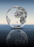 Ivory Coast on translucent globe above water