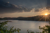 Sunset with cloudy sky at lake Edersee