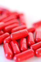 Heap of a red capsules macro