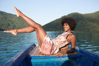 portrait of afro american woman enjoying free time on wooden boat