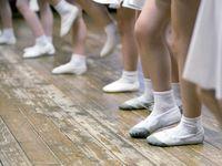 Girls in ballet school. Image of legs, close-up
