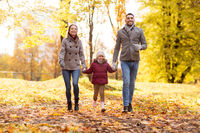 happy family walking at autumn park