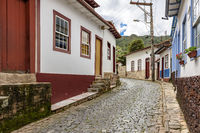Old cobblestone street with houses