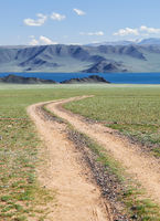 Mongolian natural landscapes with country road to the lake Tolbo-Nuur in north Mongolia
