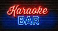 Neon sign on a brick wall - Karaoke Bar