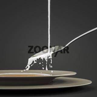milk splashing at the spoon