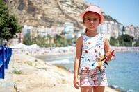 Girl 6-7 years old on Postiguet beach