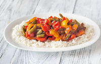 Portion of white rice and fried vegetables
