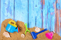 Beach poster with sand and toys