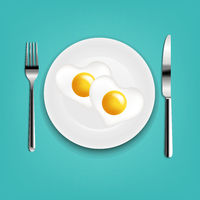 Plate With Fried Eggs Heart Fork And Knife With Mint Cloth