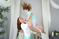 Young woman having fun with daughter