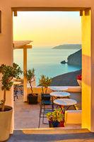 Seashore through open door in Santorini