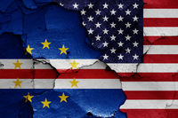 flags of Cape Verde and USA painted on cracked wall