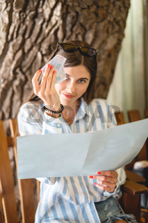 Beautiful tourist woman in restaurant watching the menu