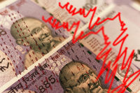 Concept of Economic slowdown showing with Indian currency notes, graphes and numbers