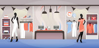 Clothes shop interior, dress and accessory boutique with racks and cashboxes