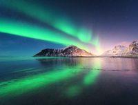 Northern lights on the beach in Lofoten islands, Norway