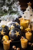 Christmas still life with ornaments and candles on wooden background