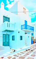 Street with small whitewashed houses in Mykonos